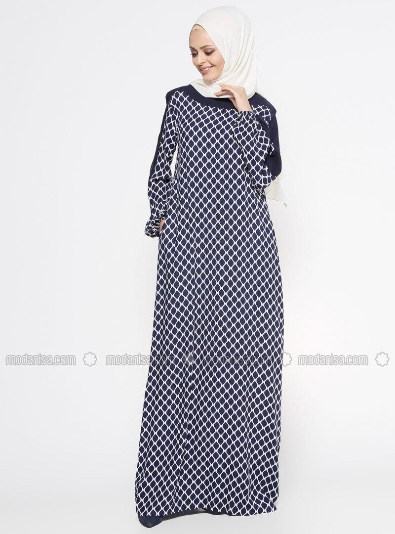e7e2e9f756 z-desenli-elbise--lacivert--ginezza-302701-302701-1.jpg