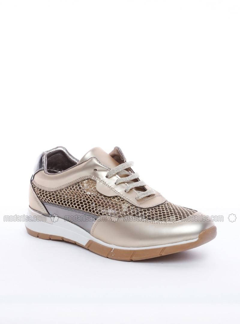 gold sport casual shoes dujour